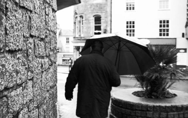 A man with an umbrella.