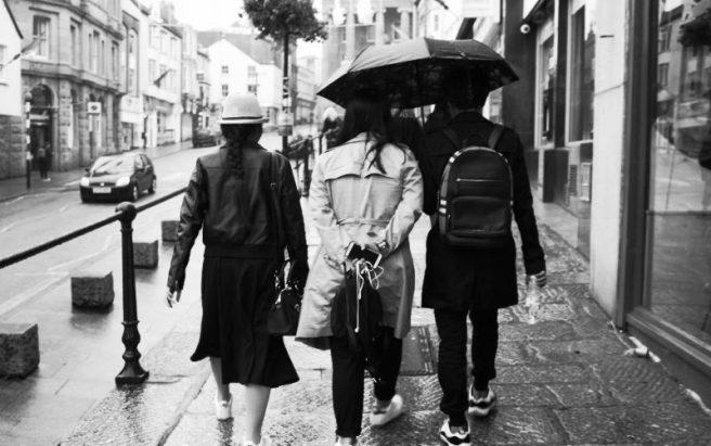 Three tourists in the rain.