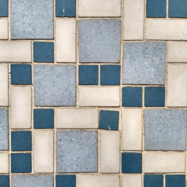 Post-war mosaic tiling.