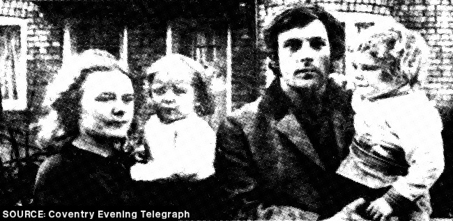 A young family in black and white.