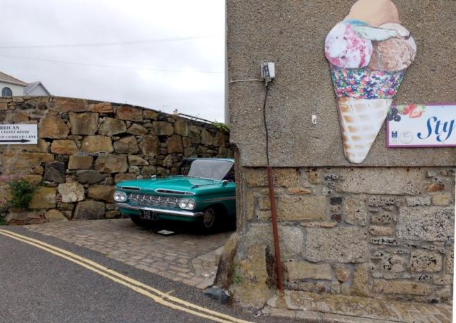 A vintage car behind an ice cream parlour in Penzance.