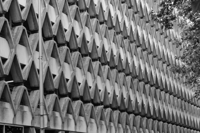 Repeating concrete patterns on a car park.