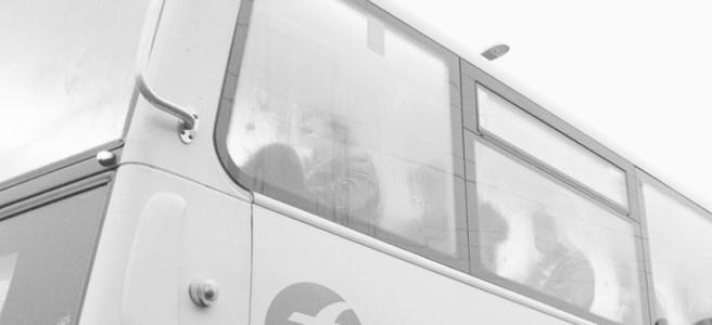 Fogged up windows on a bus.