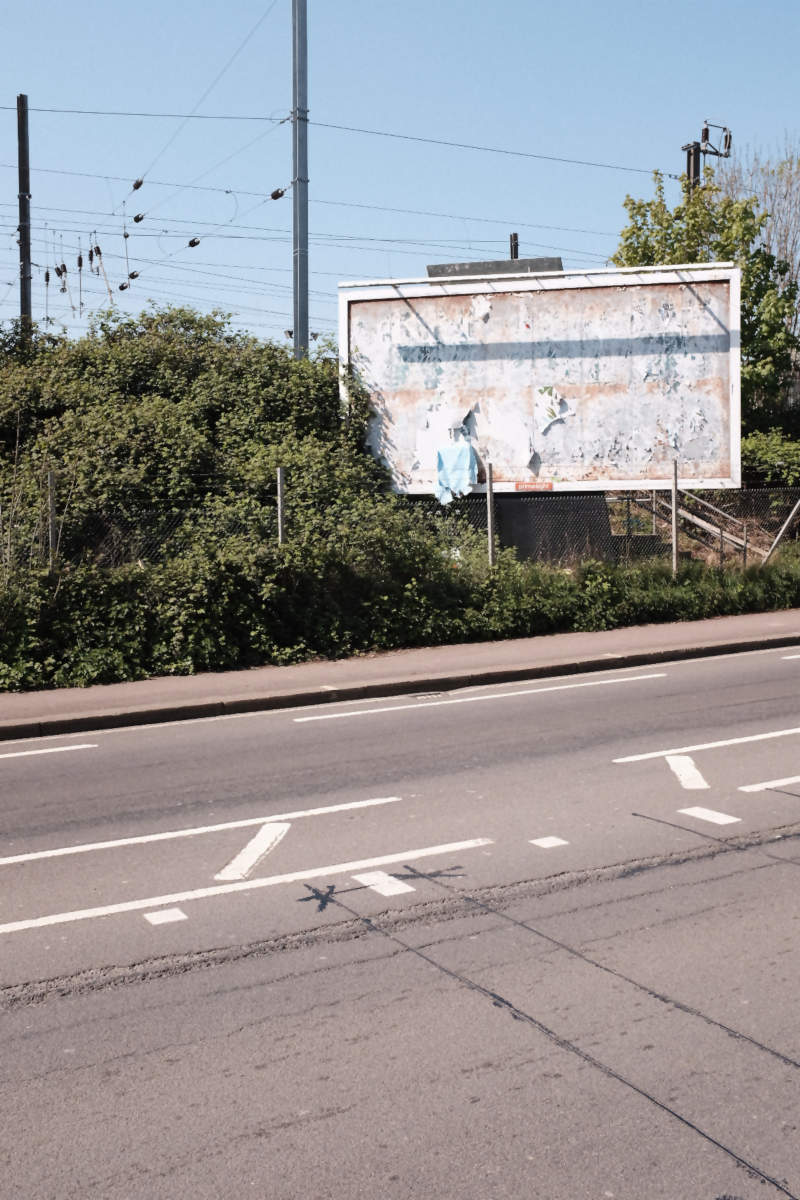 An empty road with billboard.