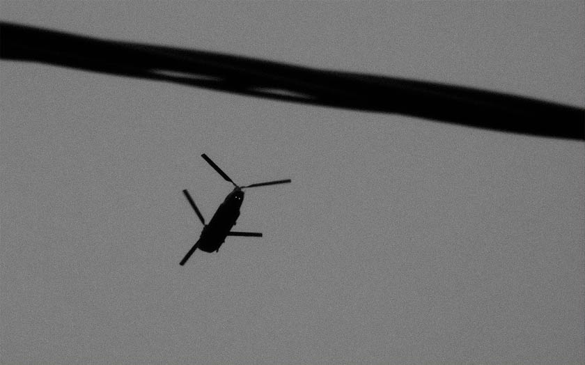 A twin-bladed helicopter in flight.